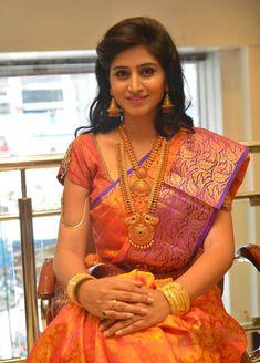 South Indian bride. Gold Indian bridal jewelry.Temple jewelry. Jhumkis. Pink silk kanchipuram sari purple blouse.Tamil bride. Telugu bride. Kannada bride. Hindu bride. Malayalee bride.Kerala bride.South Indian wedding.