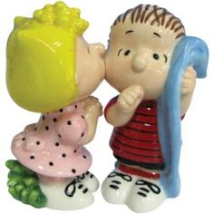 """This hilarious funny ceramic Peanuts couple makes up this cute wedding cake topper figurine with Sally kissing Linus as he holds his blanket. <br /> <br />*Please note these are salt and pepper shakers; they will small holes on their heads, and magnets in their """"mouths"""" They look very cute on the top of a cake!"""
