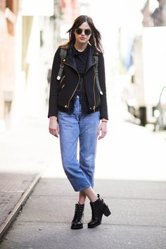 Boyfriend jeans got a slick complement from this leather jacket and a pair of lace-up boots.