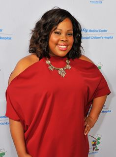 46f8d2eece5e1 Amber RIley s curls and pink lips are perfectly  Spring-appropriate Amber  Riley