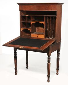 Southern Federal Walnut Plantation Desk second half 19th century, paneled walnut fallboard opening to a fitted interior, lower case with single long drawer and turned legs, finger-jointed construction, hinged top opening to a hidden compartment, 58-1/2 x 35-1/2 x 31-3/4 in.
