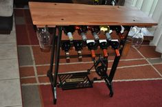 Top Sewing Machines Winerack made from old sewing machine base and new oak top Sewing Machine Drawers, Sewing Machine Projects, Sewing Machine Tables, Treadle Sewing Machines, Sewing Machine Parts, Antique Sewing Machines, Sewing Tables, Coffee Table Furniture, Decorating Coffee Tables