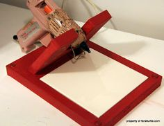 Make your own glue gun holder with wood and a piece of tile. Clever!