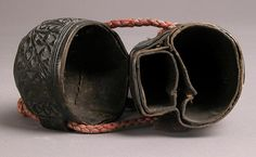 Case (étui) with an amorous inscription Date: 1450–1500 Geography: Made in Italy Culture: Italian Medium: Leather (Cuir bouilli), wood core, red cord Dimensions: Overall (case only): 8 1/4 x 3 1/8 x 3 1/4 in. (20.9 x 8 x 8.2 cm) Overall (with strap extended): 15 9/16 x 3 1/8 x 3 1/4 in. (39.6 x 8 x 8.2 cm)