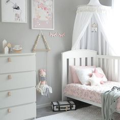 grey, white, pink girl  's bedroom