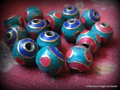 Fourteen Handmade Tibetan Brass Lapis Lazuli Coral Turquoise Beads  For your jewelry making pleasure a set of 14 handmade beads imported from Kathmandu. The combined weight of the beads is .47 ounces. Each bead measures 3/8 inches from hole to hole and 1 3/8 inch circumference. The beads are loose, lined up they would make a 5 1/2 inch strand.  by TemplesTreasureTrove, $29.95