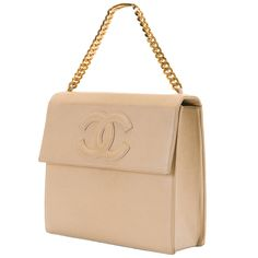 Chanel 25cm Beige Lambskin  Handbag | From a collection of rare vintage handbags and purses at https://www.1stdibs.com/fashion/accessories/handbags-purses/