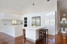 Glossy Jarrah floors with a sleek and stylish Euro gourmet kitchen