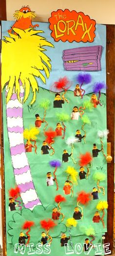 "Miss Lovie created this colorful classroom door display based on Dr. Seuss' book ""The Lorax.""  She has taken photographs of her students and they have ""Lorax mustaches"" glued on their faces."