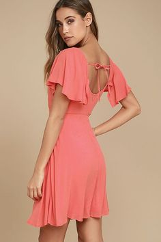 The Black Swan Cameron Coral Pink Skater Dress is always ready for any special occasion that comes its way! Lightweight woven fabric forms fluttering, elasticized sleeves atop a darted bodice, fitted waist, and flaring skater skirt. Tying back, plus hidden back zipper.
