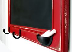 handy chalkboard frame with chalk holder and hooks. Laundry room?