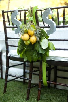 Chiavaris adorned with lemon and leaves. I love this look and actually mocked this up for my own wedding!