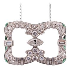 Art Deco Emerald Diamond Platinum Pendant Necklace. A gorgeous Art Deco mixed cut diamond and emerald pendant necklace. The diamonds are a combination of round, marquise and baguettes,with an estimated total weight of 1.75cts set in platinum.