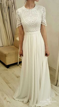 Modest wedding gown with short sleeves. Studio Levana