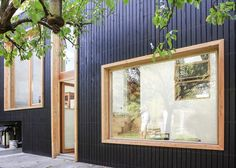 house exterior timber natural cladding white window frames - Google Search