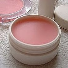 Lip balm ~  Melt 15 g beeswax or shea butter. Remove it from the heat, add 12 ml sweet almond oil, about 5-10 ml rosewater and one drop of essential lemon oil. Pour it in small pots and allow to cool.