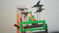 Ruby Throat Hummingbirds Whirligig This piece is one of a series of six miniature whirligigs. Only the Ruby Throat hummingbirds are for sale in this listing  Crafted in Dollhouse Miniature 1/12 scale  One of six handcrafted miniature dollhouse whirligigs. This piece is individually handmade from bass wood with metal driveshafts just as life size whirligigs are made. Each one was uniquely hand painted and will add a bit of whimsy to your dollhouse garden setting. These pieces are not toys and…