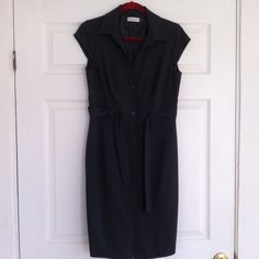 Calvin Klein - Grey Sleevless Dress Excellent condition. The price is firm and no trades. It is 39 inches long & Bust is 34 inches all around. Calvin Klein Dresses