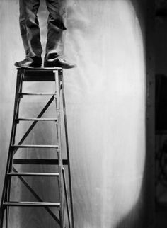 Roger Parry. Legs and feet of a man on a ladder, 1929.