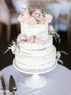 Rustic buttercream wedding cake with peach and pink flowers | We Are Origami | See more: http://theweddingplaybook.com/peach-navy-classic-waterfront-wedding/