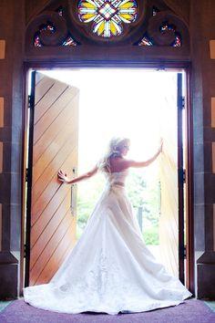 glamorous traditional wedding_bride in doorway
