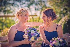 A laidback bridesmaid updo is the perfect style for a wedding in the warmer months. Photographed by Phillip Dignum Photography