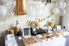 Photography: Laura Derksen - www.arrowandlacedesigns.com   Read More on SMP: http://www.stylemepretty.com/living/2014/10/31/black-and-white-1st-birthday/