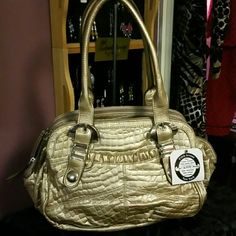 """Kathy Van Zeeland handbag. NWT Lots of zippered compartments, pockets. New, never used. Three separate zippered sections to keep things organized. A very soft patent leather style material looks as though it repels water and dirt would just wipe right off. Beautiful champagne color. Shoulder straps with approx. 9"""" drop. New with tag. Kathy Van Zeeland Bags"""