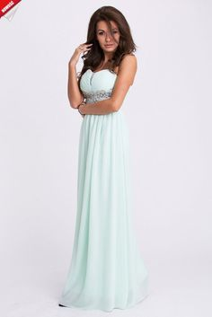 Błękitna, elegancka długa suknia ozdobiona kamieniami. #kobieta #suknia #sukienka #długa #błękitna