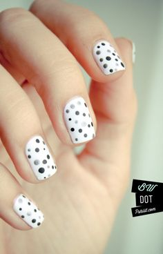 Grey and black dots on white polish. 'Dorbs.