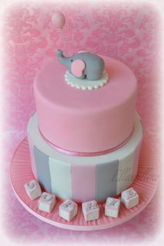 Two tier Mud cake for a Christening/ bday (bottom tier choc mud, top tier caramel mud) with little edible elephant on top.