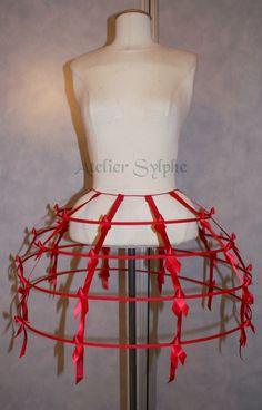 red color Crinoline hoop skirt panier 4 rows elastic waist and satin ribbon cage. $73.00, via Etsy.