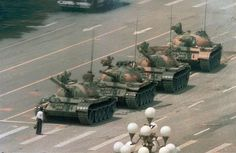 A Chinese man blocks a line of tanks on June5, 1989 the day after the government forcibly removed pro democracy demonstrators from Beijing's Tiananmn Square