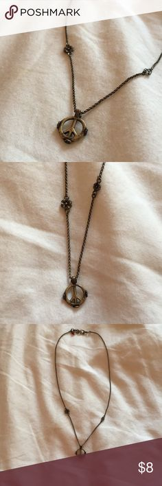 Peace sign necklace So cute and unique! Love the flowers on the side. Jewelry Necklaces