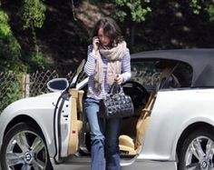 Jenifer Love Hewitt getting out of her white Bentley GTC