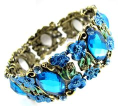 'Blue Oval Rhinestone Flower Bangle Cuff ' is going up for auction at 11pm Sat, Feb 16 with a starting bid of $8.