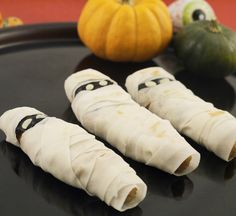 Spooky Chicken Kara-Age Mummies   | #halloween | #japan | These Spooky Chicken Kara-Age Mummies are made using crispy, seasoned kara-age chicken bites full of taste and spices, wrapped in harumaki spring roll skin strips for a ghoulish twist!
