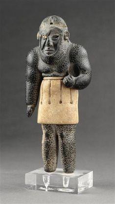 Génie balafré, antiquité orientale, calcaire, chlorite et fer, début 2e millénaire av JC, Paris, musée du Louvre
