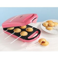Serve up scrumptious treats with this Babycakes Pie Pop maker. This handy machine will bake up to six pie pops in just minutes, so you'll have a delicious dessert ready in no time. Perfect for birthday parties, showers, holidays and more, this Babycakes Pie Pop maker will make a sweet addition to your kitchen. Great for all sorts of foods, not just pie! We have made ravioli, nachos and calazone and of course some delicious little pies…all very fast and easy and good! Price: $39.95