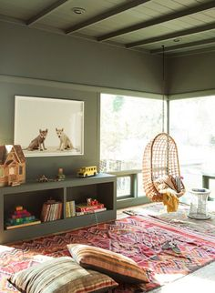 Placed by the window, this rattan swing is a nice spot for kids to read and relax.