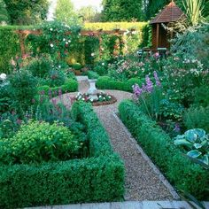 Small traditional garden This small garden has been divided into different sections, creating the illusion of space. The gravel garden path leads from the patio, to a central water feature, then onto a secluded section at the back, which houses a small summer house. #englishgardens