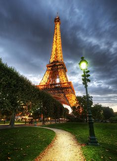 The gardens that surround the Eiffel Tower are surprisingly empty.  Around dusk and sunset, it's usually not too hard to find a nice bench to drink in the sights.  Or, barring that, there are plenty of spots in the grass where you can lay out a blanket an