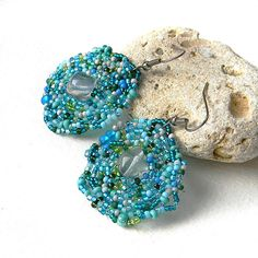 Turquoise beaded asymmetric earrings with original freeform design.    Length - 5,5 сm / 2.2 inches (including ear wires)  Width - 3,5 сm / 1.4