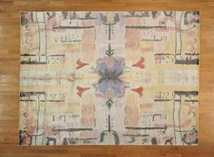 Look at the rug on a hardwood floor or get a closer look.