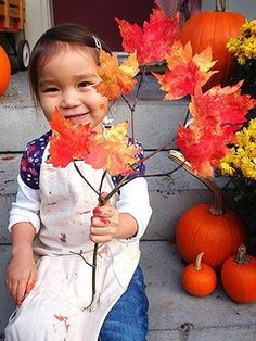 Let your kids sponge paint some paper leaves to make this beautiful branch decoration.