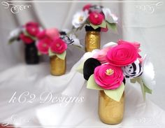 These adorable paper flower centerpieces are sure to brighten up any room they're in! They're a perfect mix of various pinks, and black and white flowers with some super cute green leaves!! The flower