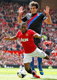 Patrice Evra goes down under a challenge from Crystal Palaces Mile Jedinak