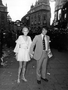 Twiggy and Justin de Villeneuve arriving at the London Pavilion for the premiere of Yellow Submarine July 17,1968
