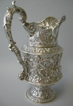 Repousse water pitcher