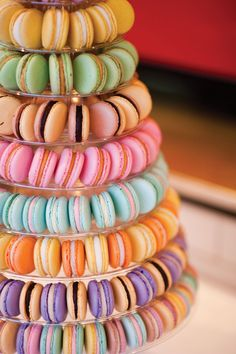 A pastel coloured macaroon tower adds to the fun of this wedding